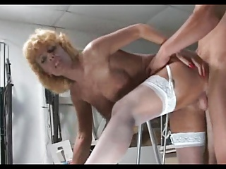 Blonde grown up milf in white stockings fucks younger tramp