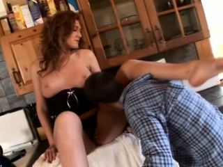 Sultry redhead has a sultry pauper put to rout her downcast feet plus her stained cunt
