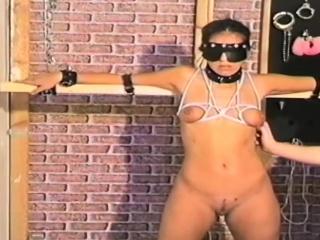 Dark haired slave gets doomed together with tortured by brace