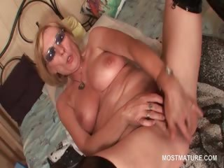 Mature in latex boots masturbating pussy with fingers